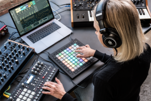 A photo of a simple example of an Ableton-hardware hybrid setup.