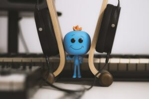 A photo of Mr Meesky in between headphones, listening to music. He knows how to have fun making music.